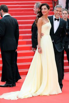 12 May Amal Clooney chose a lemon-yellow gown for the premiere of Money Monster while George looked sharp in a tuxedo.   - HarpersBAZAAR.co.uk