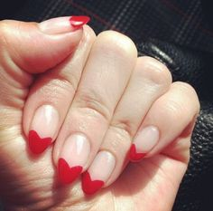 Dip a fine-tipped pencil or toothpick into red nail polish and draw a tiny heart on your nail and paint inside.  #nailpolishmodels #trendnails #mattenailpolish #colorfulnail #artificalnail #simplenailart
