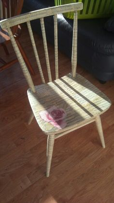My first decoupage chair, using old hymn sheets and a rose...