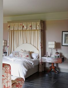 A Pretty Floral Palette Pops Against Black Painted Floors In The Guest  Bedroom.
