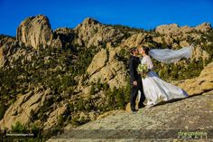 Bride and groom portrait in front of Twin Owls at Lumpy Ridge, Rocky Mountain National Park