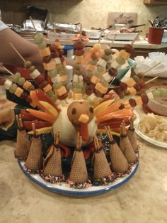 Get the children to help make these Thanksgiving appetizers: fruit, veggie, and cheese turkey, with ice cream cone teepees.