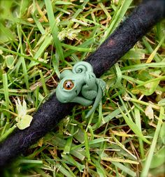 dreadlock bead dragon - green. $12.00, via Etsy.