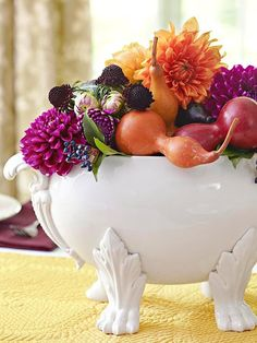 An unusual container makes a great centerpiece: http://www.bhg.com/thanksgiving/indoor-decorating/easy-centerpieces-for-thanksgiving/?socsrc=bhgpin092814unusualcontainers&page=28