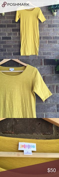 NWOT Lularoe Yellow Julia Dress In a gorgeous bright yellow, this Julia Dress by lularoe can be dressed up or down. Made from a cotton/spandex blend, this dress is cool and comfortable. In excellent condition. Approximate measurements lying flat: Bust 17', Waist 15', Length 37.5' 30178 LuLaRoe Dresses Midi
