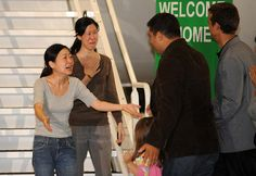 Journalists Euna Lee and Laura Ling, who had been arrested in North Korea and sentenced to 12 years hard labor, are reunited with their families in California after a successful diplomatic intervention by the U.S.
