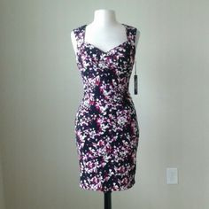Instantly slimming floral print dress Shell: 95% polyester,  5% spandex, built in shape wear that slims and smooths, hidden back zip, fully lined with instantly slimming technology,  bust 33 inches, waist 26 inches, hip 34 inches, length 36 inches White House Black Market Dresses