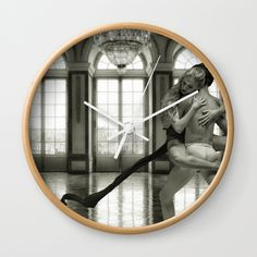 "Good times! Rethink the traditional timepiece as functional wall decor. You'll love how our Artists are converting some of their coolest designs specifically into Wall Clocks. Constructed with premium, shatter-resistant materials, with three frame color options.      - Natural wood, black or white frame options   - Dimensions: 10"" diameter, 1.75"" depth   - Choose black or white hands to match frame or design   - High-impact plexiglass crystal face   - Backside hook for easy hanging"