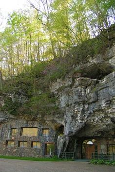 Beckham Creek Cave Lodge. A modern hotel built into a living cave ~ You can explore caves, hike, fish, go horseback riding or rock climbing here ~ Ozark Mountains, Arkansas.