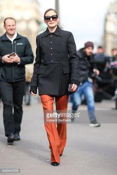 Olivia Palermo wears a black military jacket and orange pants outside the Miu Miu show during Paris Fashion Week Womenswear Fall/Winter 2017/2018 on...