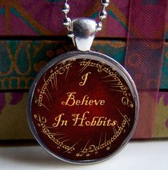 Lord Of The Rings Pendant I Believe In Hobbits by ShimmerCreek, $8.95 THis would be great with an actual Tolkien quote in the middle :-)
