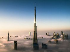 The worlds tallest building, the Burj Khalifa, juts above the morning fog in Dubai. The fog is common at this time of year and is burned away as the sun rises. The tower stands at 828 metres (2,717ft) #dubai #uae
