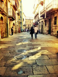 Santiago de compostela. Pretty much all streets in Spain look like this one. It's beautiful!!