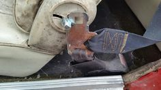 Rusty seat belt latch, and mold
