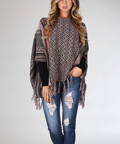 A modern rendition of the classic poncho, this tribal-print version features cozy armholes that allow you to wear it like a sweater.