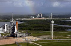 Two shuttles, Atlantis (foreground, STS-125), and Endeavour (background, STS-400) on launch pads at the same time, with Endeavour ready for a potential rescue mission.