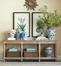 Well balanced nice large scaled jars are in proportion to the oversize console table.
