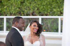 The happy couple right at the end of the ceremony. The bride's classic curls and lacy veil are too perfect.