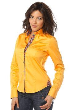 01607e87095 Chemise femme orange unie se distinguant par un intérieur col et poignet en  madras marron. Les pattes de boutonnage allient originalité et côté décalé.