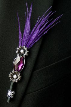 Purple   Boutonnieres - no flowers but a feather?