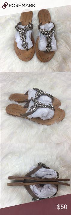 Antik Batik   Jeweled Embellished Flip Sandals 38 Antik Batik jeweled flip flop sandals. White jewel embellishments on tan straps. Fair condition. Wear to soles. Left sandal with some damage, as shown in final photo. Size 38 = 8. Offers & bundles welcome. Antik Batik Shoes Sandals