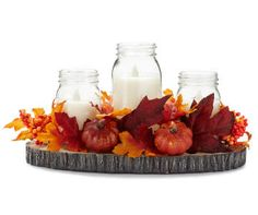 Take your autumn décor to the charming country side with this lovely mason jar harvest tray. Decorated in adorable pumpkins, berries and leaves, the three mason jars flicker warm radiance with their LED flames. Its generous size and wonderful construction makes this perfect for a mantel or as your Thanksgiving centerpiece.