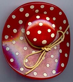 Bakelite red with white polka dots hat pin