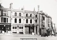 NORTH STREET AND QUEEN SQUARE. Derelict houses, 113, 114, 115, North Street in 1938. They were to remain like this, shored up, until 1951 when they were removed as unsafe and the site has been completely empty ever since.