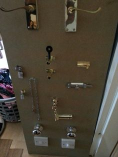 Handles, locks and switches for heuristic play. Have a larger door frame surrounding it with only one key the parent has so parent can always unlock it :)