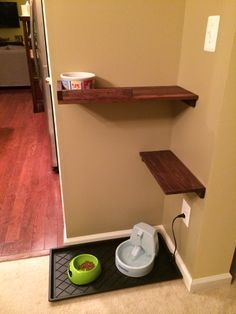 """Our cat & dog feeding area.  It was easy to build and is working perfectly. We used a few old Ikea shelves we had sitting around, some 1"""" x 2"""" wood and some leftover wood stain."""