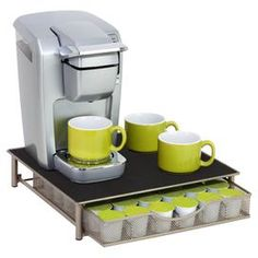 "Keep your home organized and clutter-free with this essential selection.  Product: Coffee pod drawerConstruction Material: MetalColor: Silver and blackFeatures: Convenient pull-out drawerDimensions: 3.11"" H x 14.29"" W x 12.99"" D Note: Coffee maker, mugs and pods are not included Cleaning and Care: Wipe  clean with damp cloth"