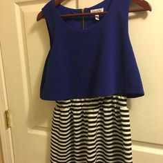 Cute black white and blue dress I am 5'4 and comes to around my knees. Very cute dress only wore it 2 times. Dresses