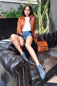 Olivia Culpo wearing Chloe Nomadic Leather Jacket in Ochre, Chloe Faye Bag in Tobacco and Chloe Kris Denim Ankle Boots