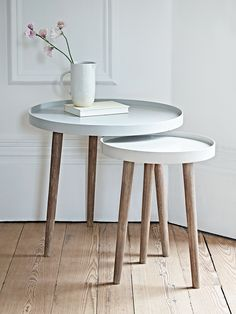 With three Scandinavian style white cedar legs and a smooth modern painted top, our Lina Side Tables are finished in two complimentary shades, the larger a light grey and the smaller a soft putty. Use alone as a stylish side table or nest together to make