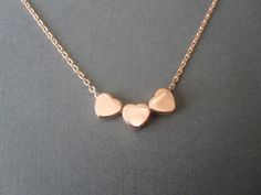 Triple Tiny Rose Gold Heart Necklace by BeasJewels on Etsy, $15.00