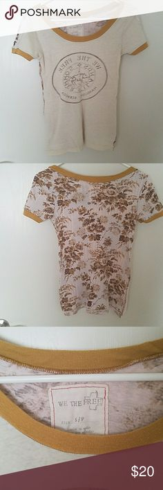 Free people graphic t small This is the cutest t shirt. I wish it still fit me! Cream, mustard, pink, and brown colors with lace detail on the sleeves Free People Tops Tees - Short Sleeve