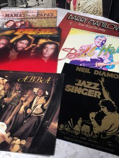 LARGE BOX LOT OF VINTAGE VINYL RECORDS INCLUDES SOME OF THE FOLLOWING ARTISTS: SIMON AND GARFUNKEL, THE MAMAS AND THE PAPAS, RICKY NELSON, ELVIS PRESLEY, BARRY MANILOW, WILLIE NELSON, LITTLE RICHARD, GLEN CAMPBELL, NEIL DIAMOND, ABBA, THE BEE GEES, ETC