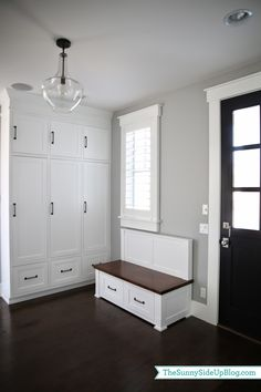Sunny Side Up: Mudroom - love the painted door, the bench and the planation shutters.