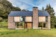 Best Ideas For Modern House Design : – Picture : – Description Hall + Bednarczyk Architects paired rugged sandstone with contemporary details to create this rural house in Wales. Residential Architecture, Architecture Design, Architecture Ireland, Vernacular Architecture, Chinese Architecture, Futuristic Architecture, Casas Containers, Rural House, Modern Barn