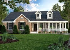 <ul><li>With a big wrap-around porch in front and a covered patio in back, this Ranch house plan keeps you sheltered from the hot sun.</li><li>Both the breakfast nook and the formal dining room have tray ceilings are are set in a bay making them feel larger.</li><li>The great room is enormous and can be seen right from the foyer.</li><li>Triple windows let you look out onto the back patio.</li><li>All the bedrooms...