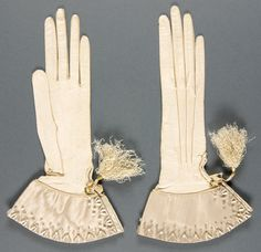 Woman's wedding gloves, 1888: ivory kid, silk faille, beads, silk tassels. (Philadelphia Museum of Art collection)