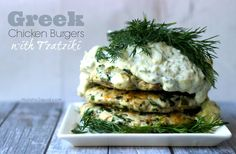Greek Chicken Burgers with homemade Tzatziki are perfect prepared on the grill. Ditch dry, tasteless chicken or turkey patties for moist, delicious flavor.