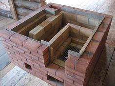 rocket stove and grill Build Outdoor Kitchen, Outdoor Stove, Outdoor Kitchen Design, Rustic Kitchen, Rocket Mass Heater, Diy Storage Shed, Cooking Stove, Rocket Stoves, Summer Kitchen