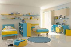 Fashionable Blue Yellow Twin Bedroom Design With Bookshelf To Separate