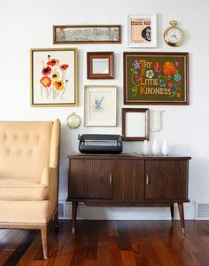 A charmingly vintage gallery wall.--with crewel! I just love the crewel poppies!