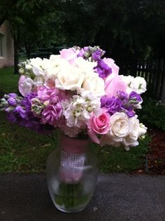 Pink, purple and white themed bridal bouquet created by Lexington Floral in Shoreview, MN.    #flowers #bride #wedding