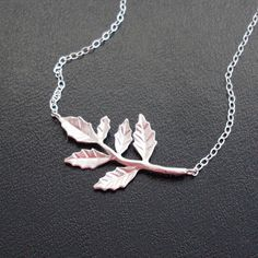 Silver branch necklace.
