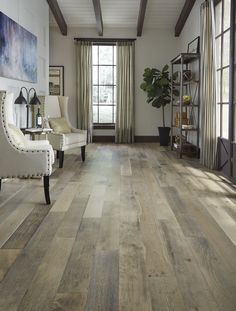 If you like a distressed look, then you'll love the wirebrushed surface of Vintage French Oak. The wide hardwood planks feature a variety of hues blended with classic oak grains and will complement any room in your home. http://www.lumberliquidators.com/ll/c/Vintage-French-Oak-Wirebrushed-Virginia-Mill-Works-Engineered-HSQCVF6/10041169