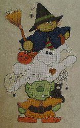 Carolyn Manning Designs - Blight Broomhilda & Booz, uses Kreinik holographic colors in cross stitch.