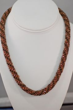 Over 300 Swarovski round crystals sparkle in this necklace. These round crystals…